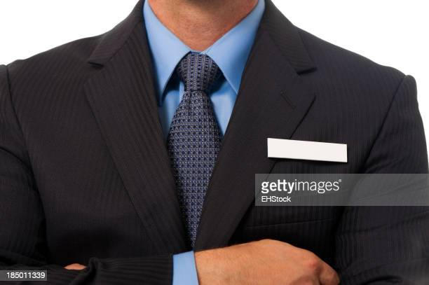 Businessman with Blank Name Tag on White