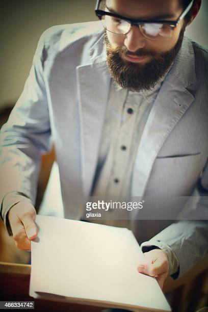 Businessman with blank paper sheet.