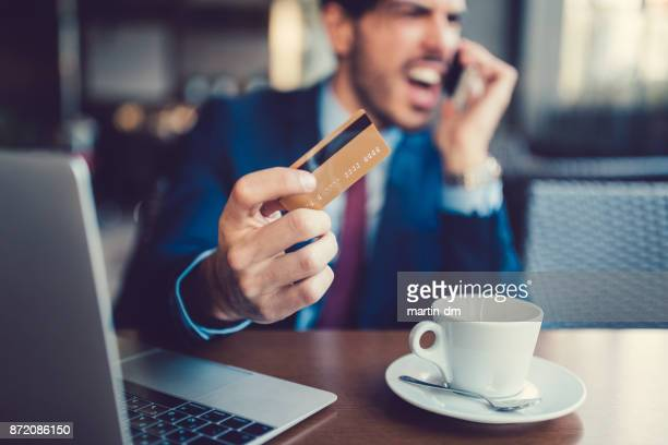 Businessman with blocked credit card