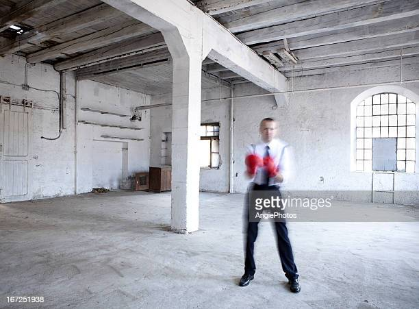 Businessman with boxing gloves in motion