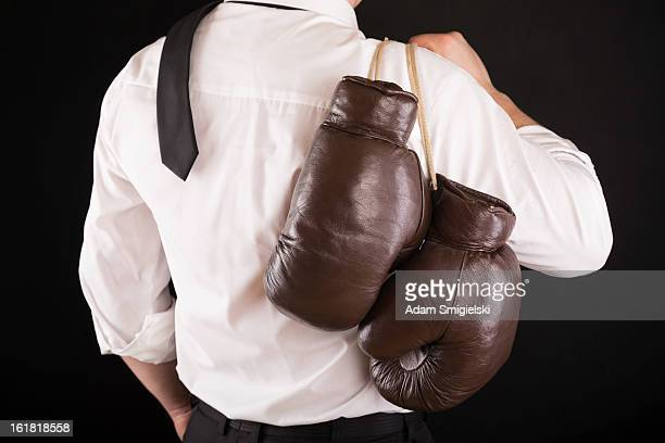 businessman with boxing gloves - brown glove stock pictures, royalty-free photos & images