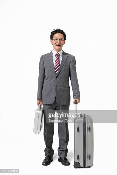 Businessman With Briefcase And Suitcase