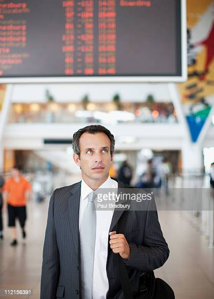 Businessman with briefcase in airport