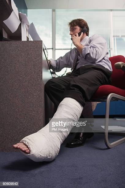 Businessman with broken leg