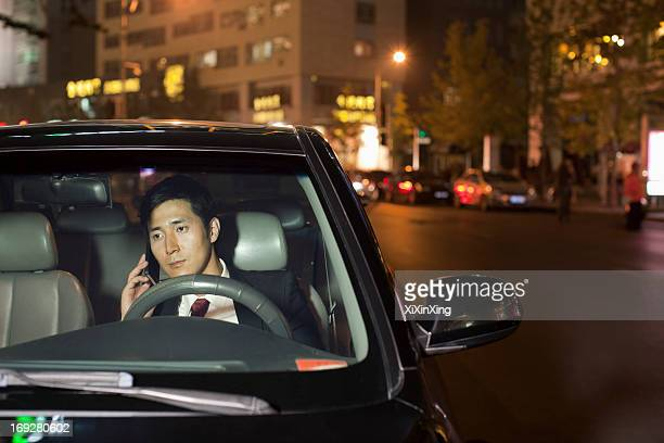 Businessman With Cell Phone In Car
