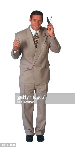 businessman with cellular telephone - brown suit stock photos and pictures