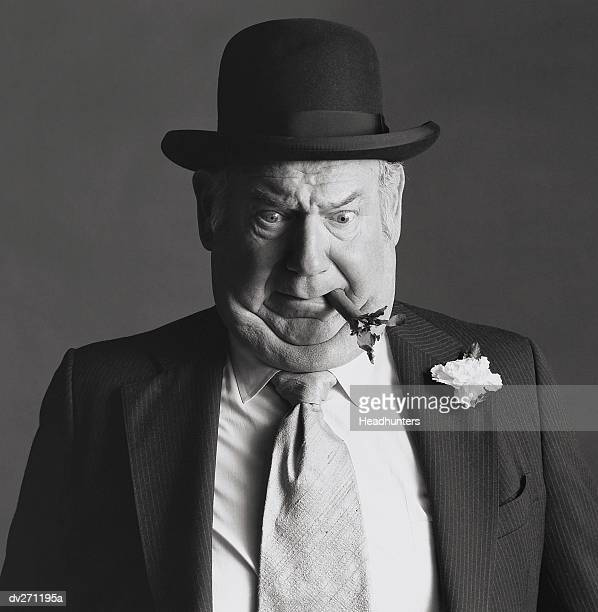 Businessman with cigar in mouth