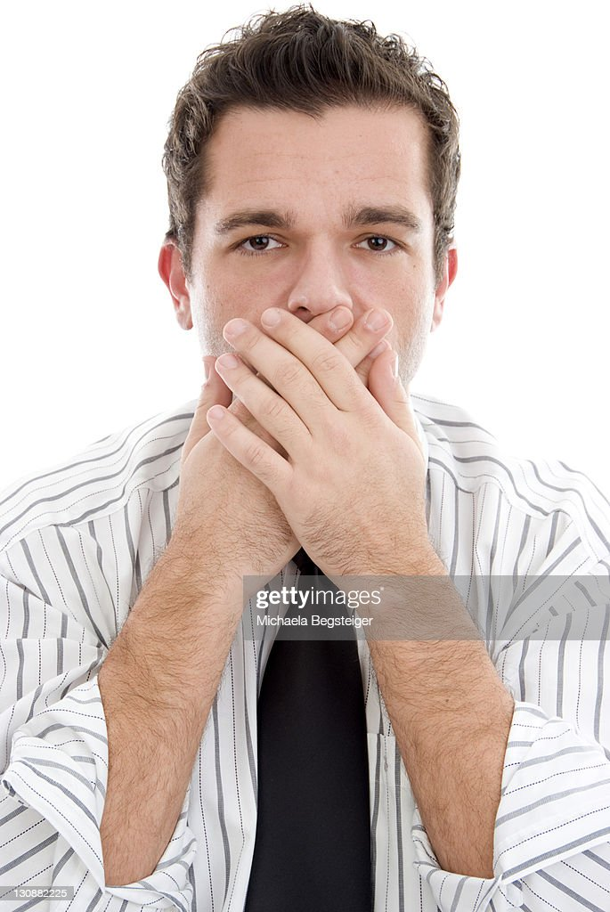 Businessman with closed mouth : Stock Photo