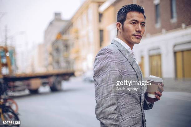Businessman with coffee cup outdoors