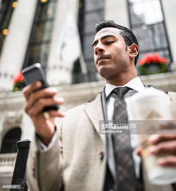 Businessman with coffee mug on manhattan