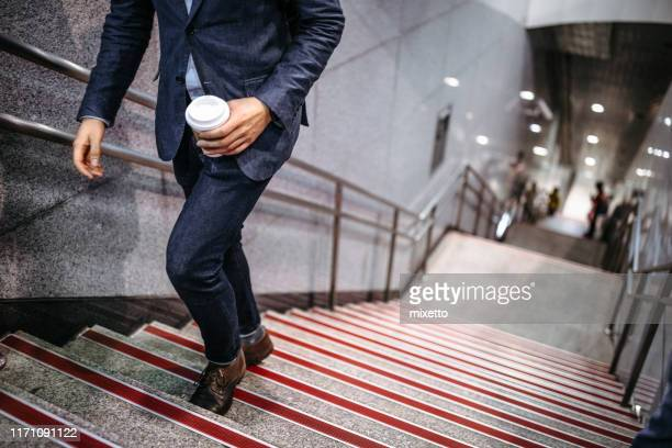 businessman with coffee on way to work - moving up stock pictures, royalty-free photos & images