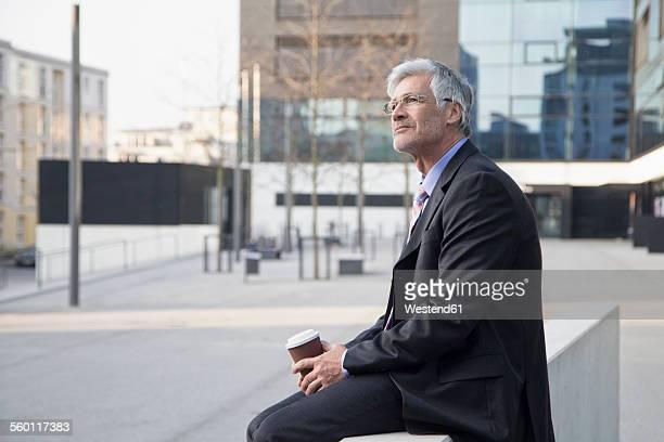 Businessman with coffee to go