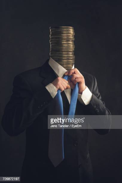 businessman with coins for a head - greed stock pictures, royalty-free photos & images