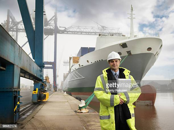 Businessman With Container Ship
