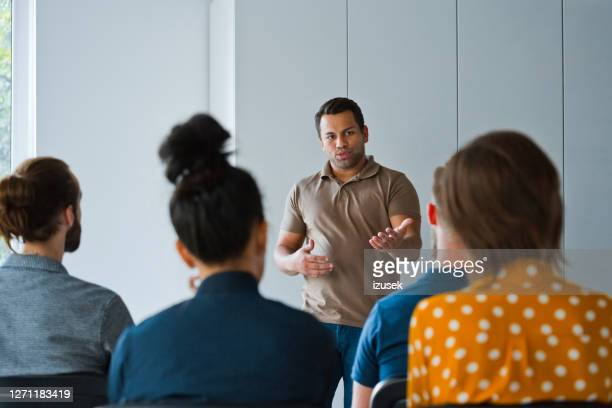 businessman with coworkers in new office - small group of people stock pictures, royalty-free photos & images