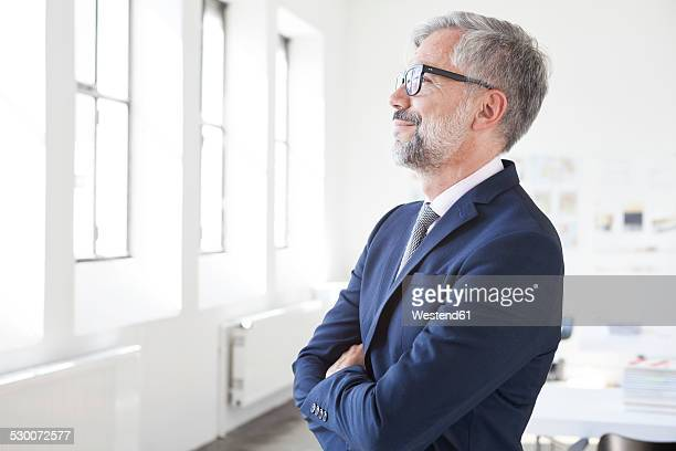 Businessman with crossed arms standing in an office