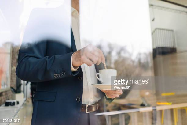 Businessman with cup of coffee at the window