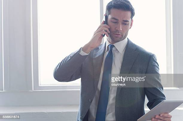 Businessman with digital tablet and mobile phone.