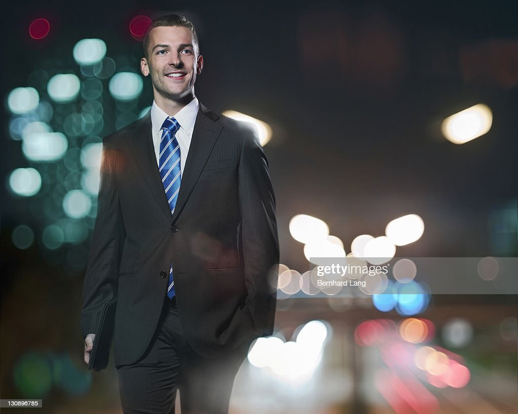 Businessman with digital tablet at night : Stockfoto