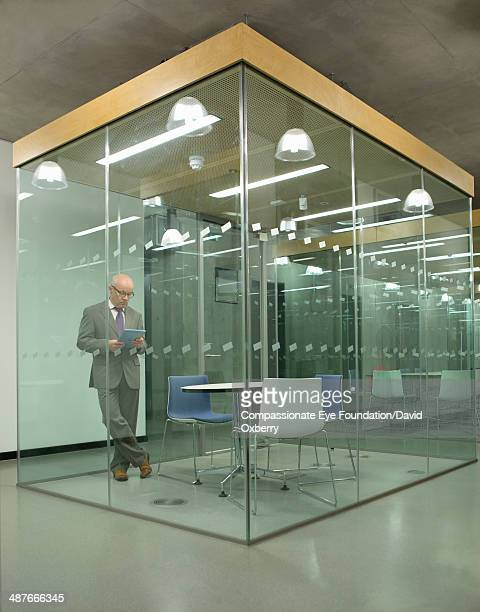 Businessman with digital tablet in conference room