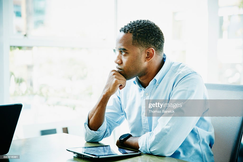 Businessman with digital tablet sitting in office : ストックフォト
