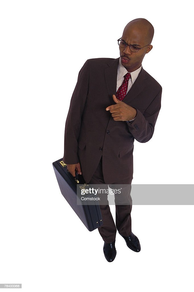 Businessman with distasteful expression : Stockfoto