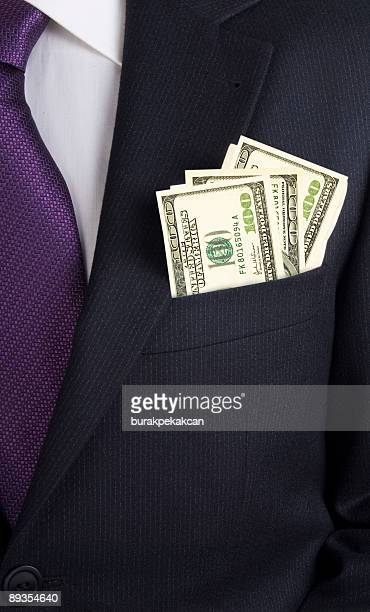 businessman with dollars in his jacket pocket - pocket stock pictures, royalty-free photos & images