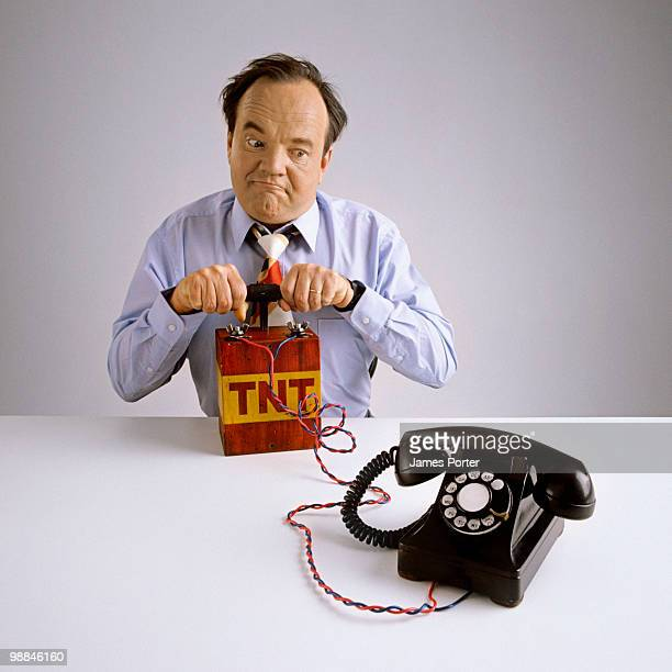 businessman with dynamite and telephone - dynamite stock photos and pictures