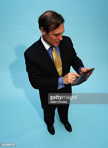 Businessman with Electronic Organizer