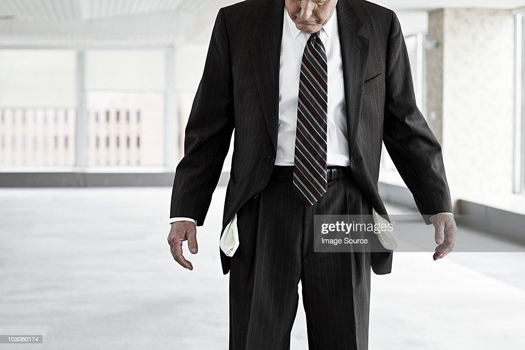 Businessman with empty pockets : Stock Photo