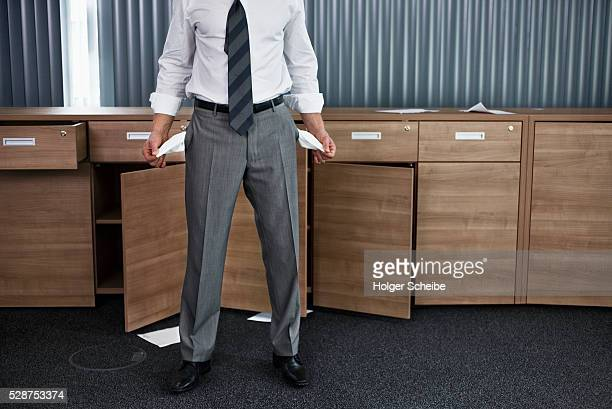 businessman with empty pockets - bankruptcy stock pictures, royalty-free photos & images