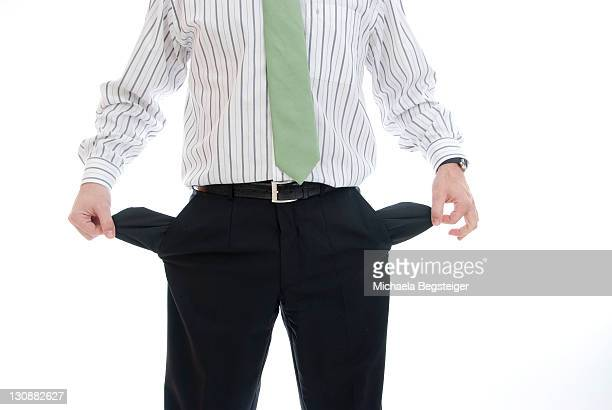 Businessman with empty trouser pockets
