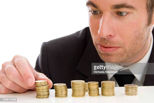 Businessman with Euro coins