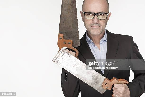 Businessman with eyeglasses holding two saws