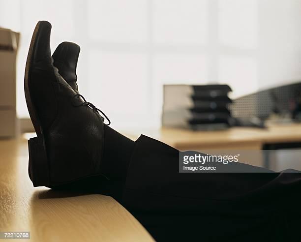 Businessman with feet on desk