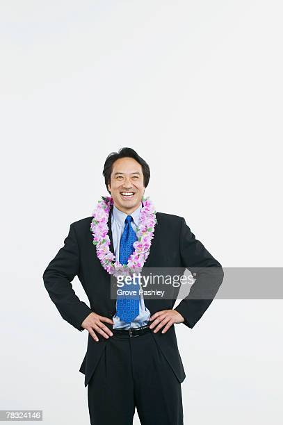 Businessman with floral lei