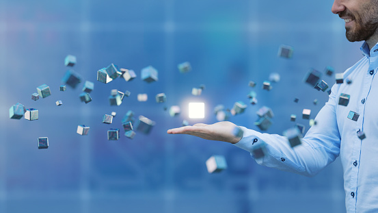 Businessman with flying cubes 670060572