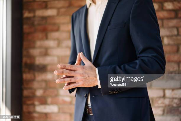 Businessman with folded hands