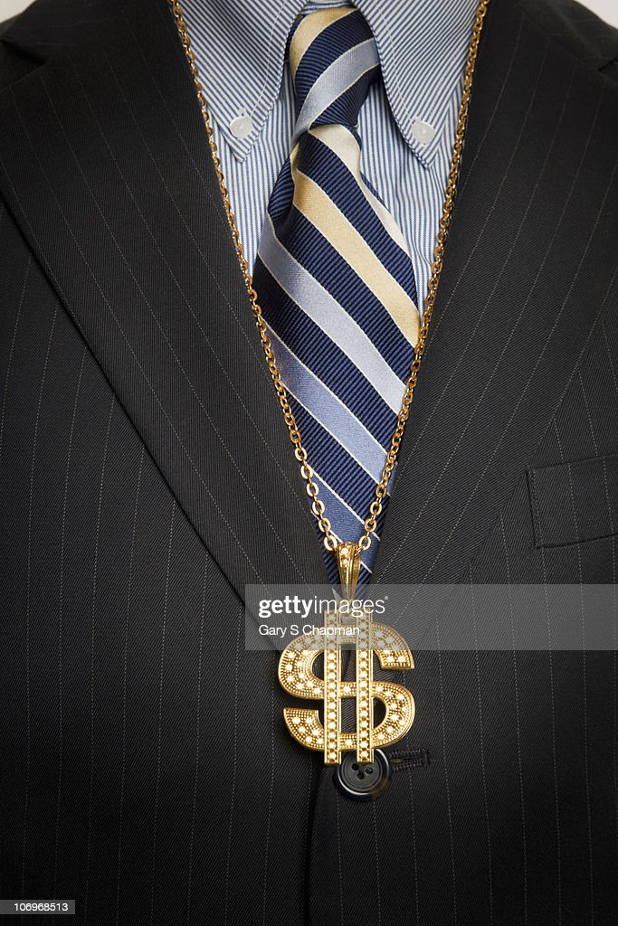 Businessman with gold dollar sign bling necklace : Bildbanksbilder