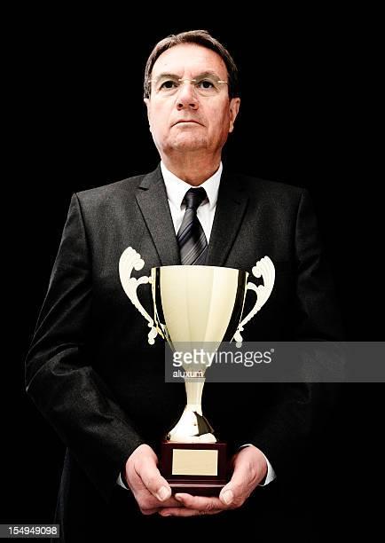 businessman with golden trophy