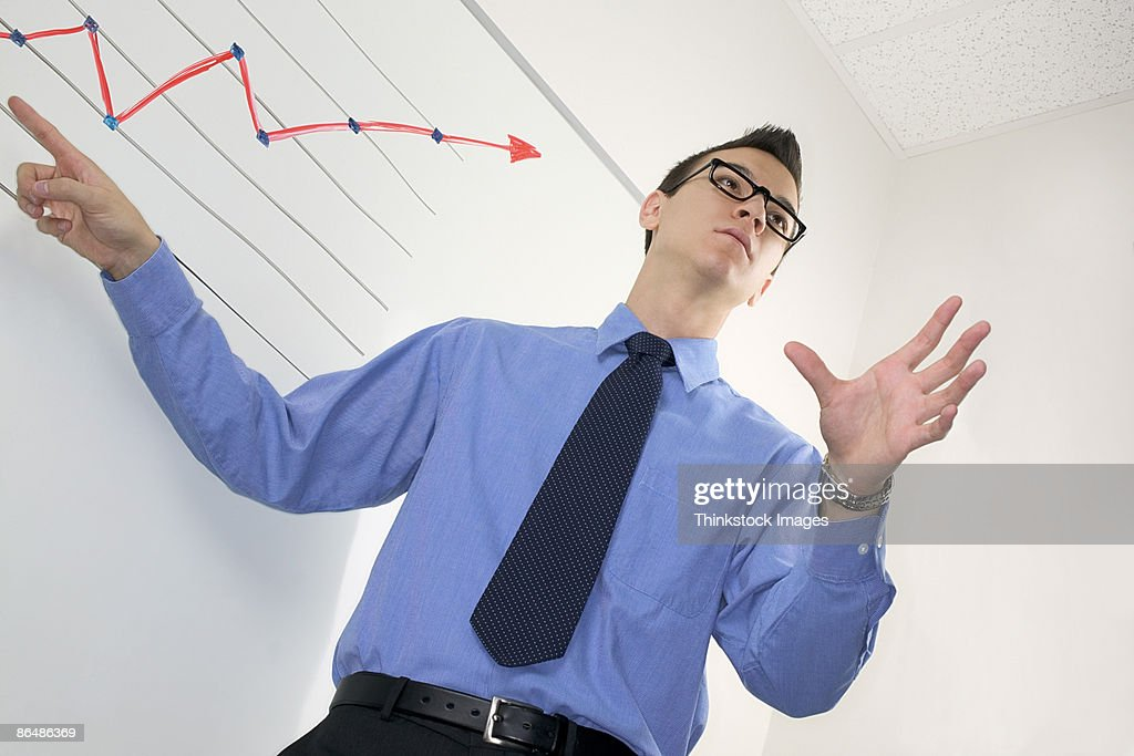 Businessman with graph : Stock Photo