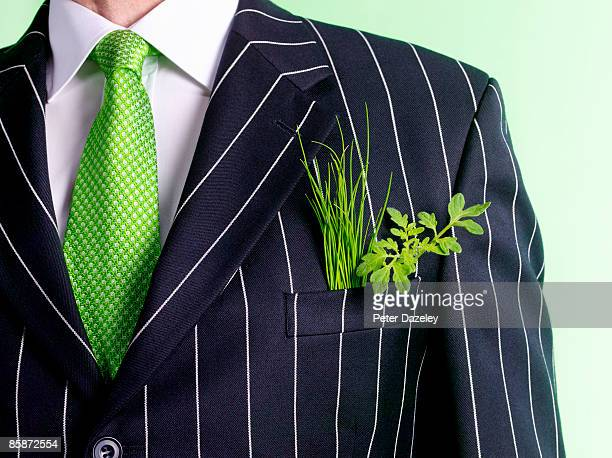 Businessman with green shoots.
