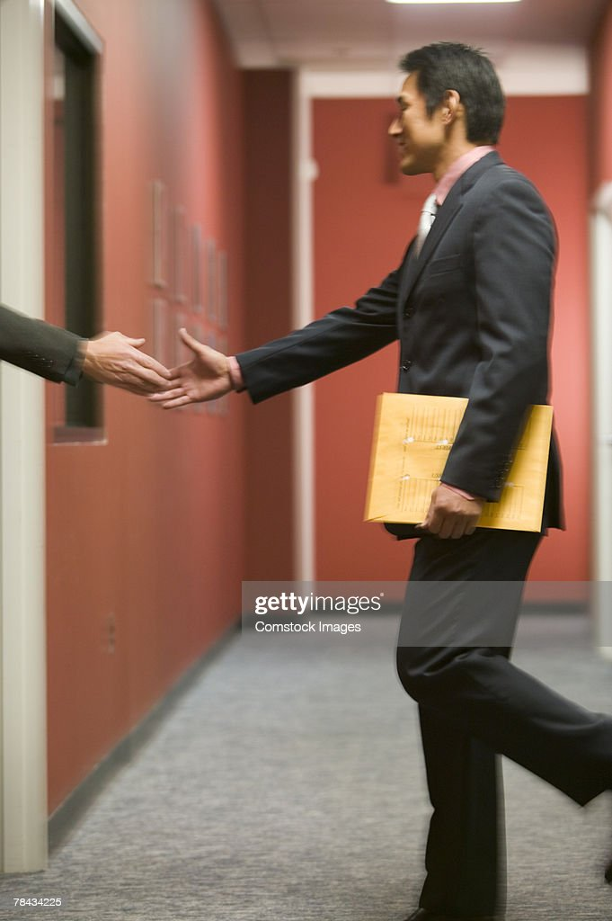 Businessman with hand extended : Stockfoto