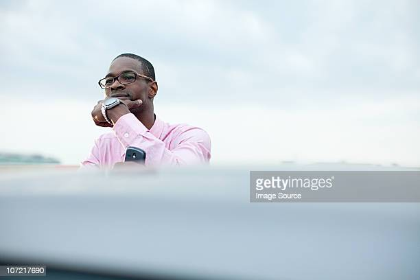 Businessman with hand on chin