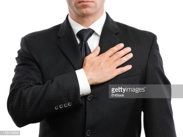 Geschäftsmann mit Hand mit Herzen auf Weiß