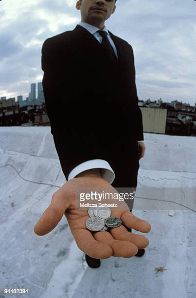 Businessman with handful of change