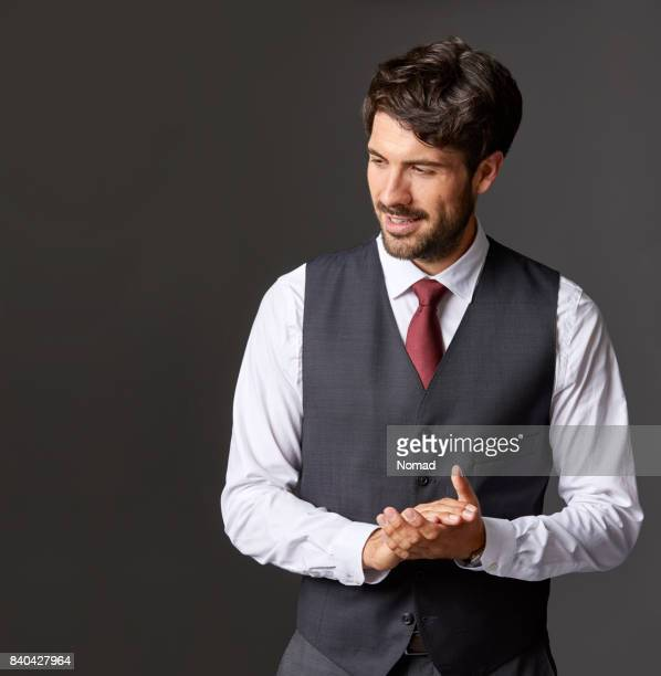 businessman with hands clasped looking away - waistcoat stock photos and pictures