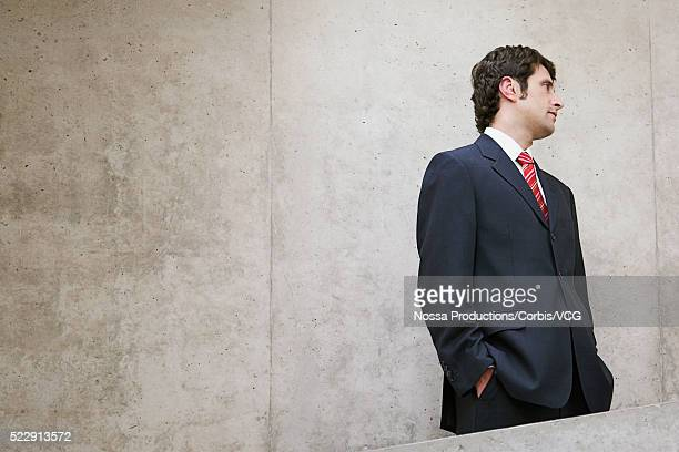 businessman with hands in his pockets - vcg stock pictures, royalty-free photos & images