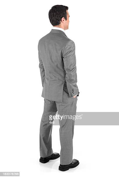 businessman with hands in pockets - grey suit stock pictures, royalty-free photos & images