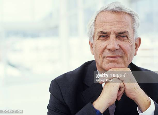 businessman with hands on chin, close up, portrait - 60 64 years stock pictures, royalty-free photos & images